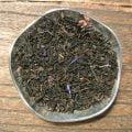 Svart te med smak av mousserande vin och jordgubb. En kopp av detta i morgonsolen och frukosten är fulländad.
