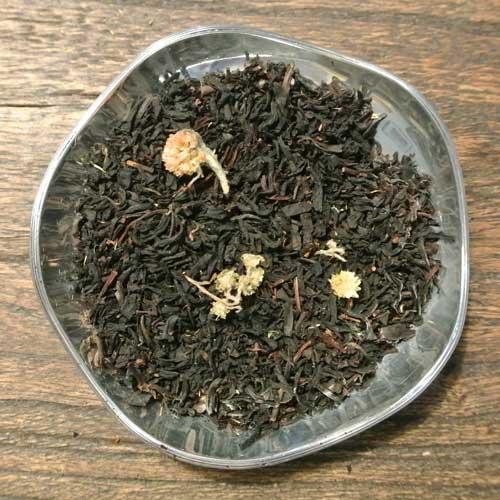 Citrus och gräddkola - svart te