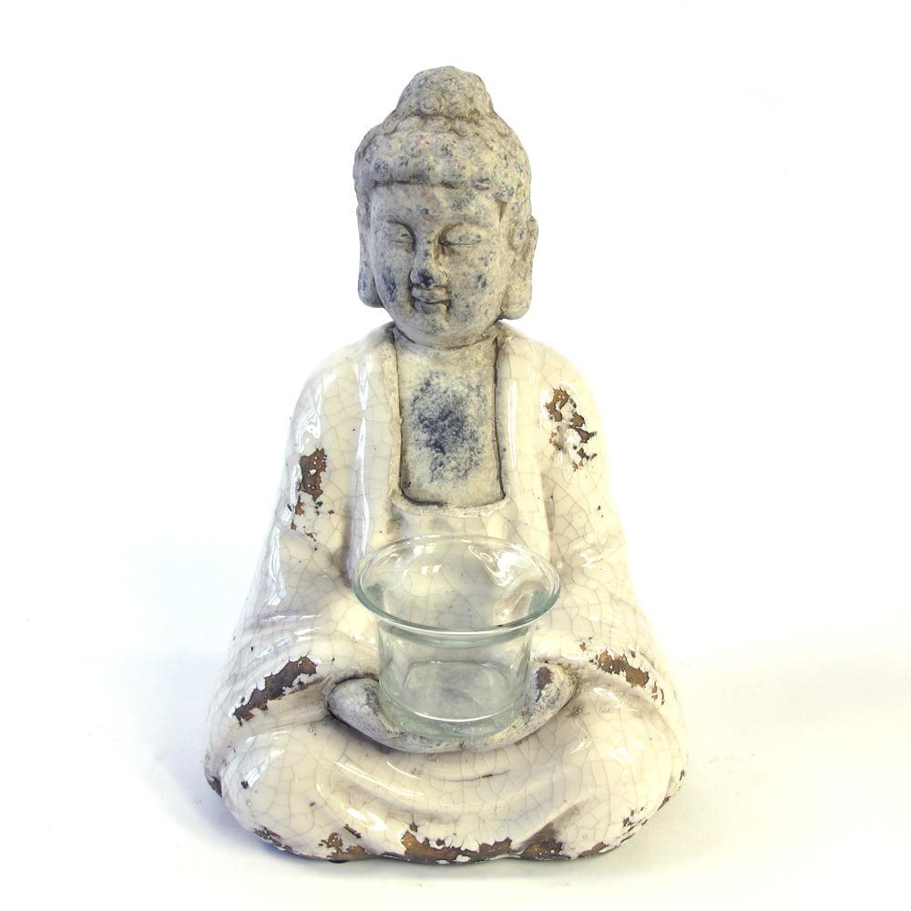 Buddha i vit keramik med hållare för värmeljus, mått 13x17 cm.